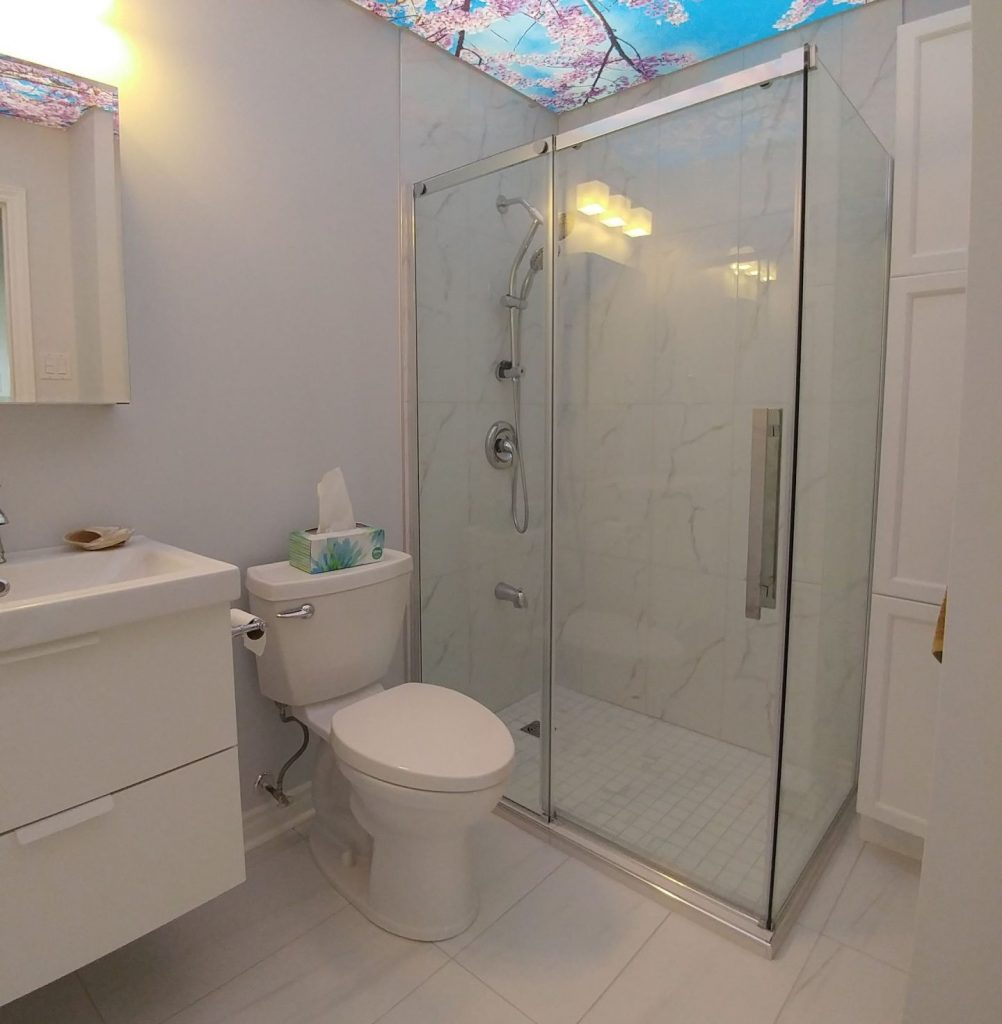 bathroom renovation with walk in shower and printed ceiling