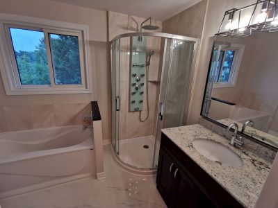 modern bathroom with walk in shower and small bathtub