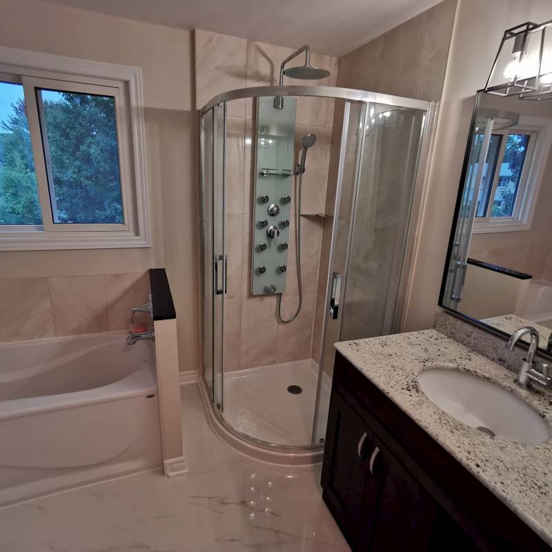 modern bathroom with walk in shower and small bathtub