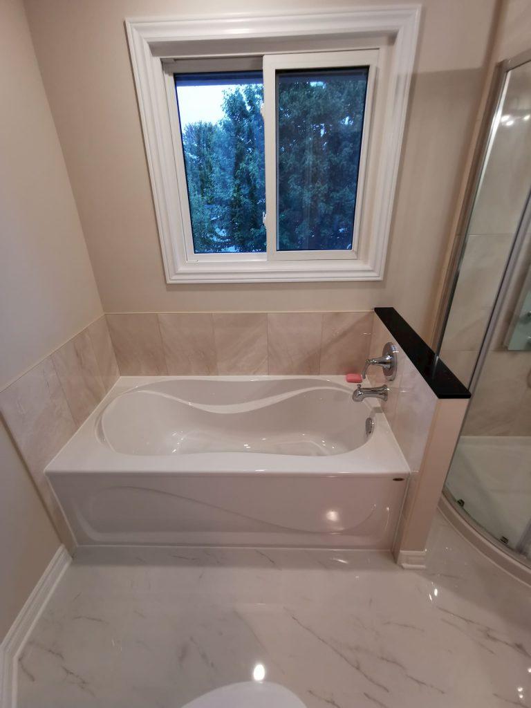 small bathtub in custom bathroom renovation