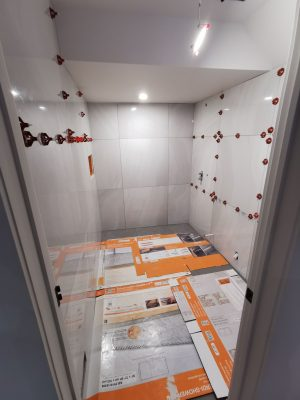 basement bathroom renovation - wall tile install