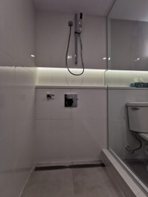 small bathroom remodeling with back lit storage space