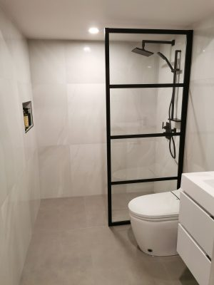 modern bathroom with black glass enclosure - renovations ottawa